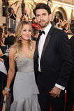 Kaley Cuoco stayed close to her new husband, Ryan Sweeting, on the red carpet.