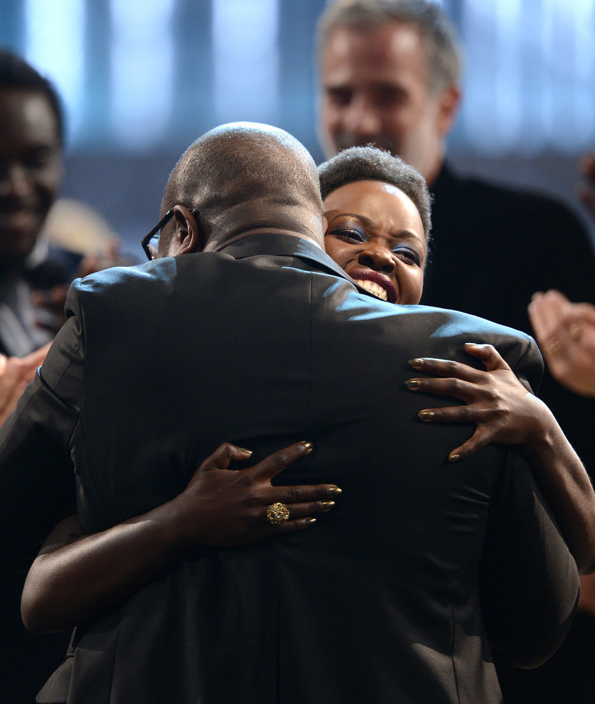 Steve McQueen hugged Lupita Nyong'o after she won.