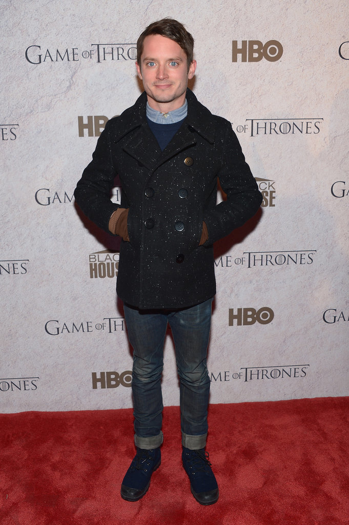 Elijah Wood stayed warm in his peacoat on Saturday.