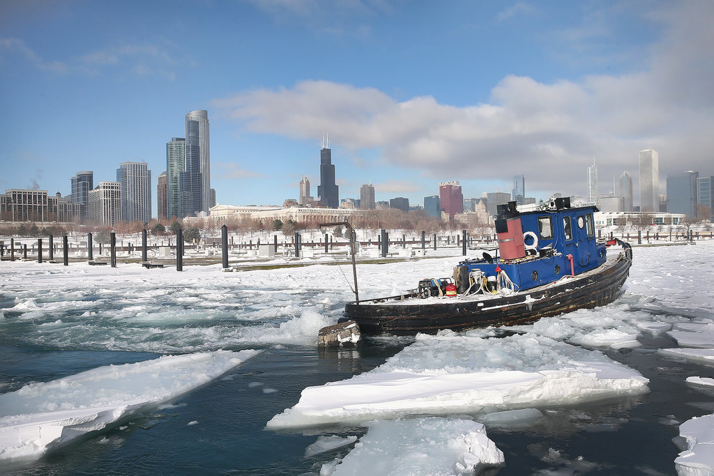 A tugboat broke up the ice near downtown Chicago.
