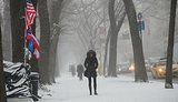 In NYC, a woman bundled up to brave the cold during Winter storm Janus.