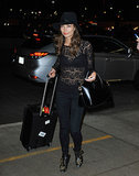 Lily Aldridge brought a sexier style to the airport with a sheer, black lace top.