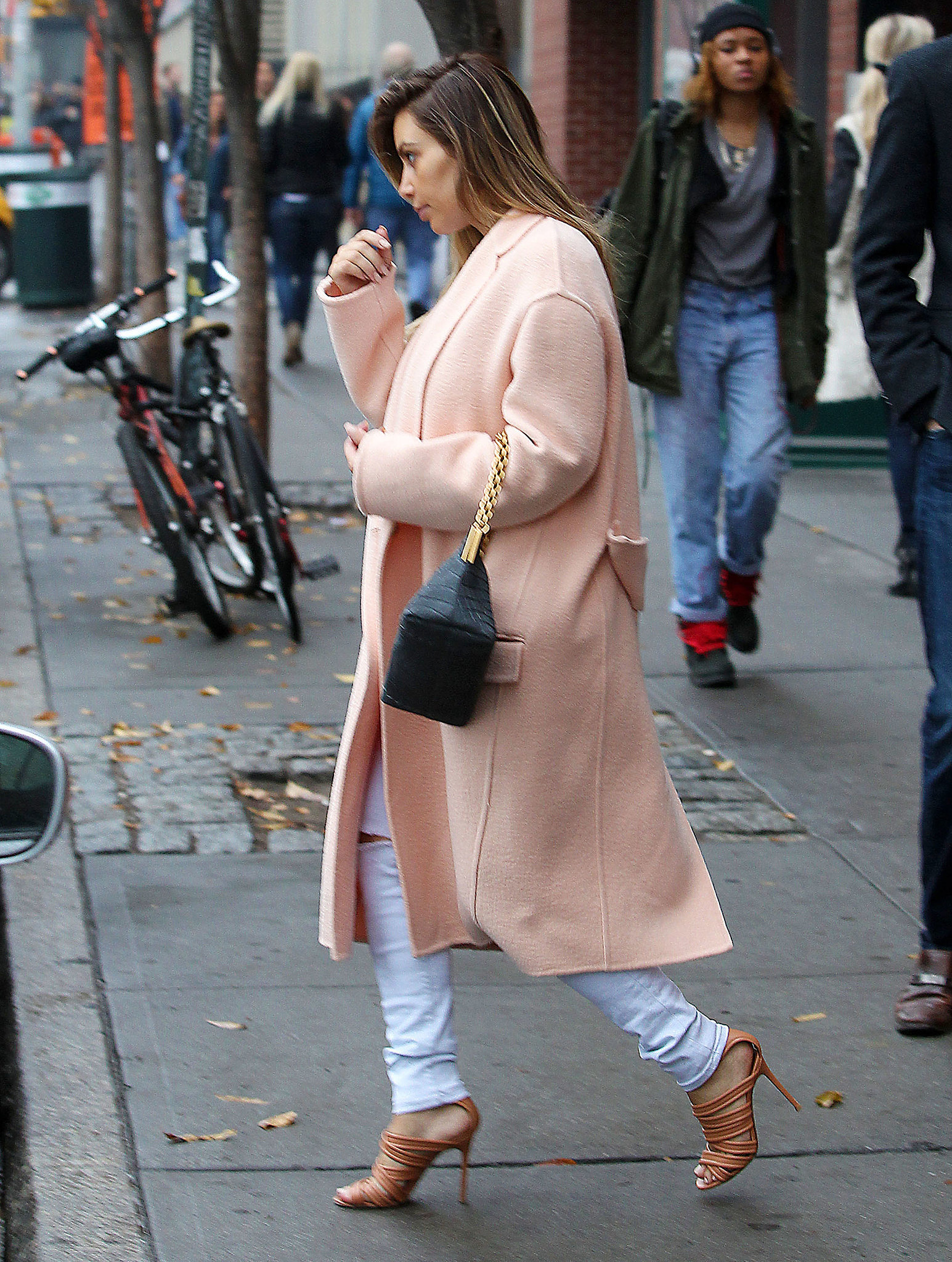 Kim Kardashian topped her monochrome ensemble with a plush pink Céline coat and strappy nude sandals in November 2013. Where to Wear: A drive-in m
