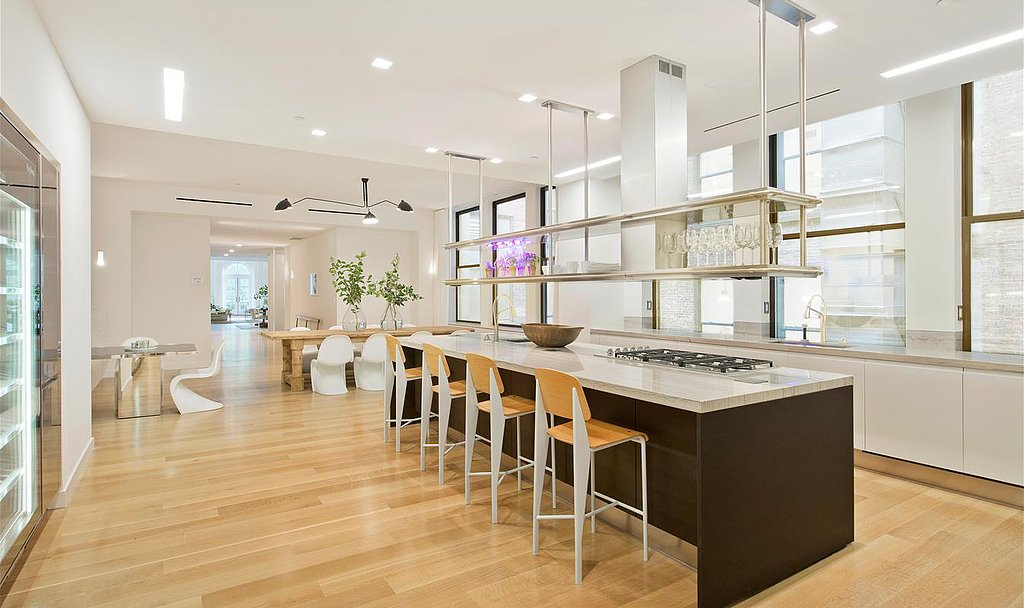 The ample counter seating is a perk, but we can't take our eyes off that fabulous floating shelf! Source: Douglas Elliman Real Estate