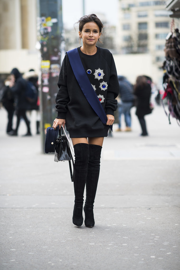 Another style win for Miroslava Duma in an oversize, jeweled sweatshirt and over-the-knee boots.  Source: Le 21ème | Adam Katz Sinding
