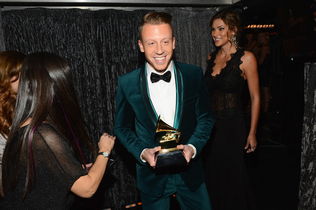 Macklemore brought his Grammy statue backstage.