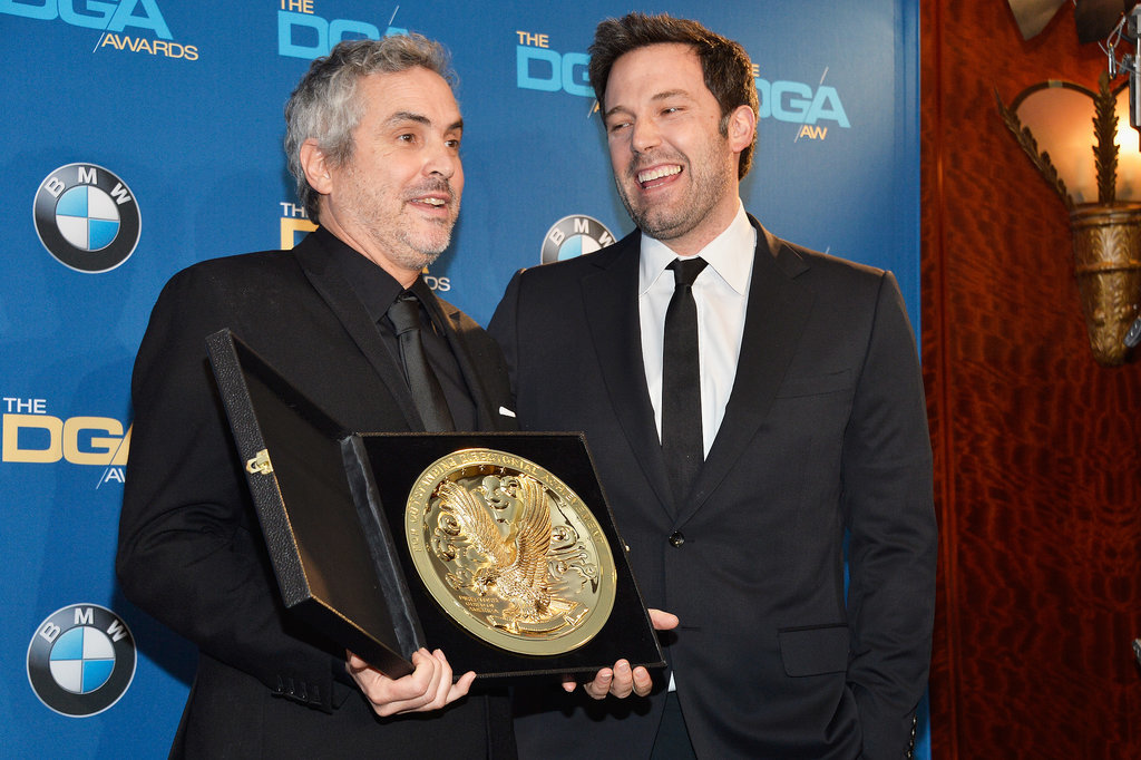 Ben Affleck posed for pictures with Alfonso Cuarón in the press room.
