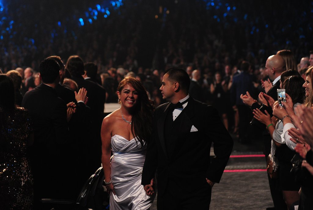 The crowd applauded as the couples made their way through the aisles.