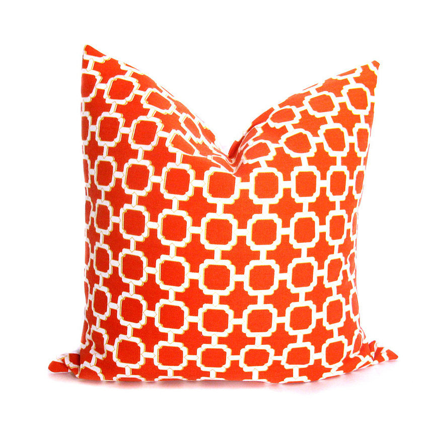 For a colorful pattern in your space, consider this orange pillow ($17).