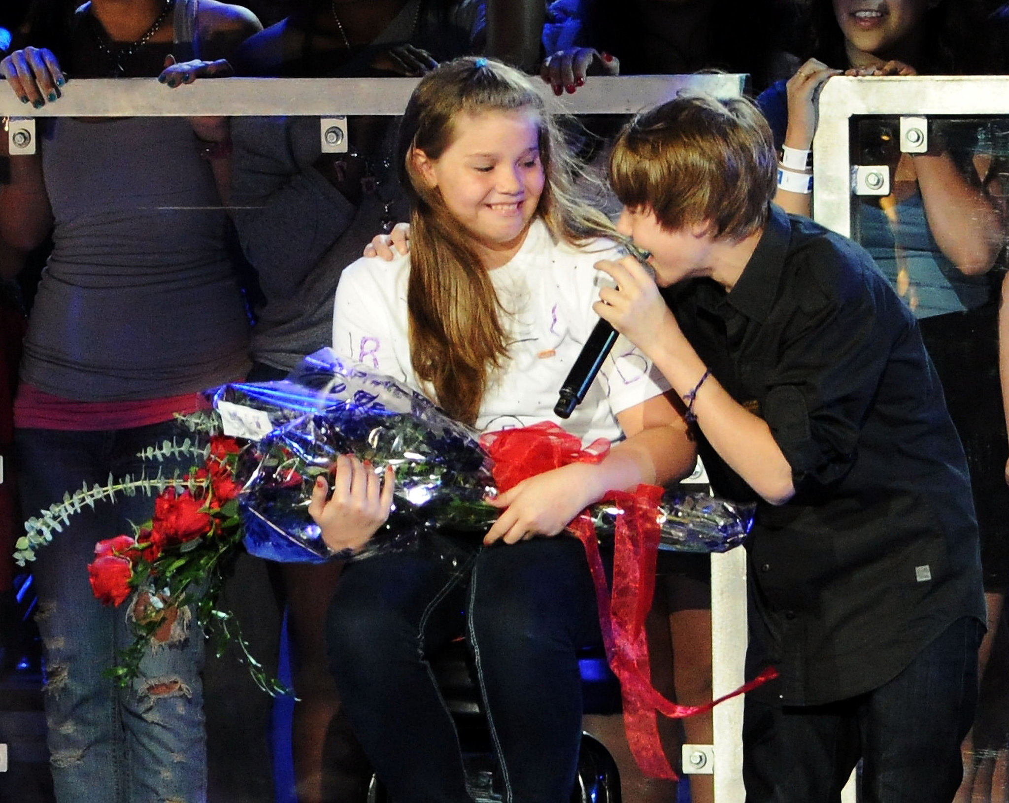 A young Justin Bieber sang to a fan on stage at the Pepsi Super Bowl Fan Jam in 2010.