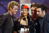In July 2002, Alicia Keys joined Justin and the guys of *NSYNC to present an award at the American Music Awards.
