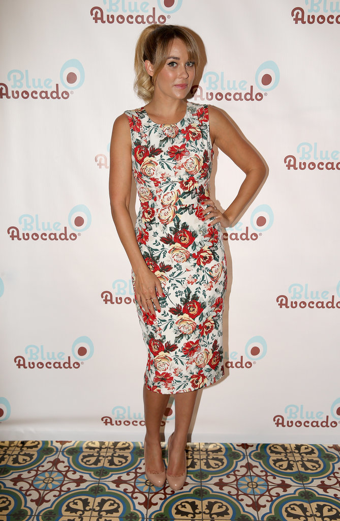 Conrad was high tea ready in a blossoming Paper Crown holiday collection sheath for the launch of her BlueAvocado XO(eco) collection in September 2013.