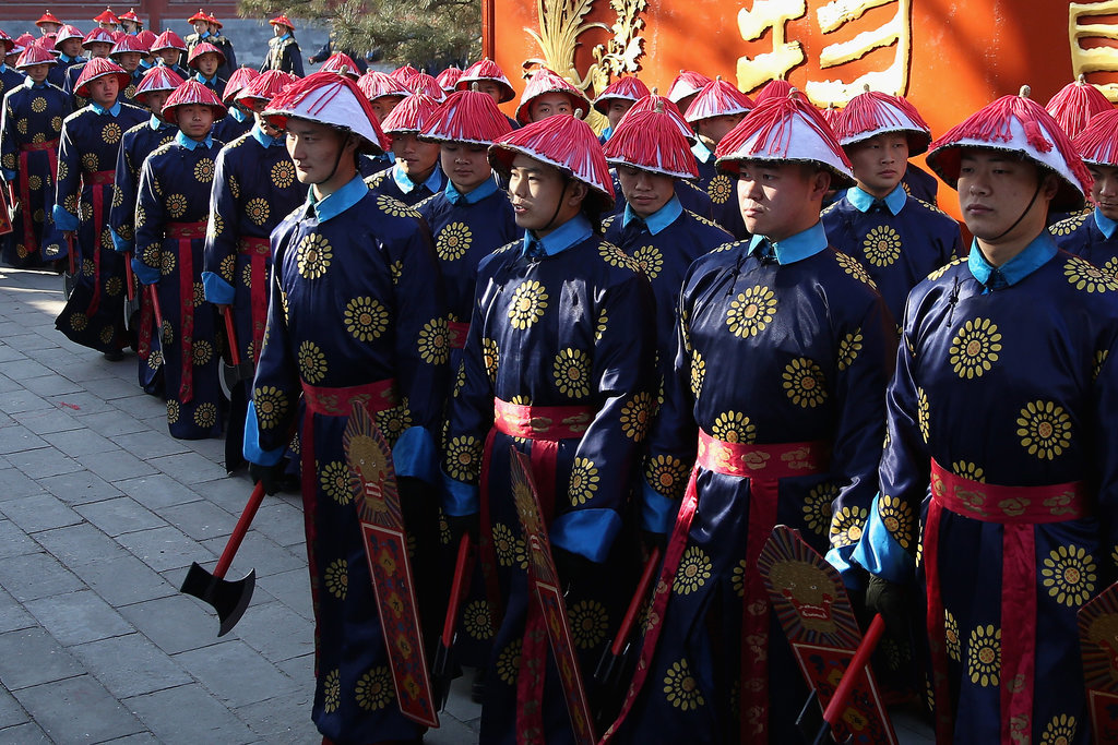 In Beijing, Chinese paramilitary police officers reenacted an ancient ceremony.