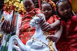 Kids held on to a horse figurine, which symbolized the Year of the Horse, in the Philippines.