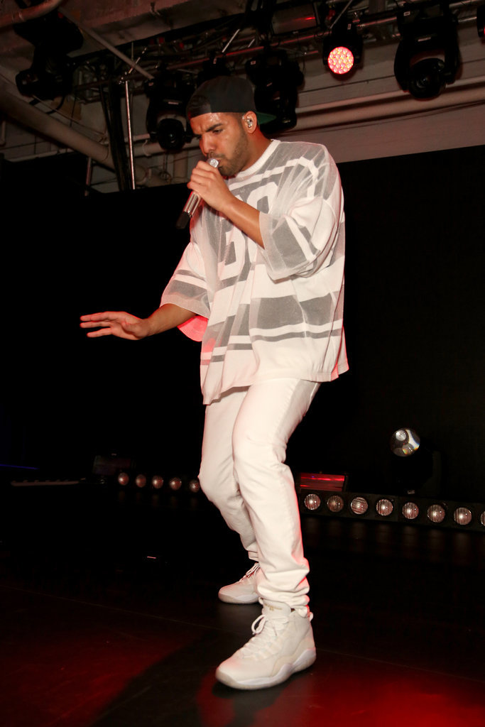 Drake got on stage for a performance during the Revolt party.