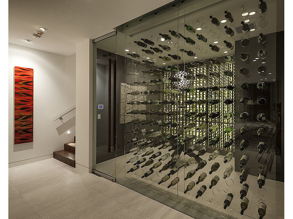 Instead of a wine cellar, this wine room provides a place to sip wine with company. Source: The Agency