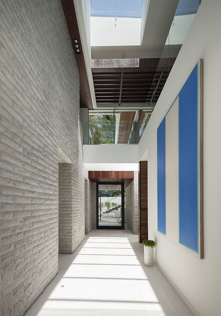 Skylights and a massive painting give this space an art museum feel.  Source: The Agency