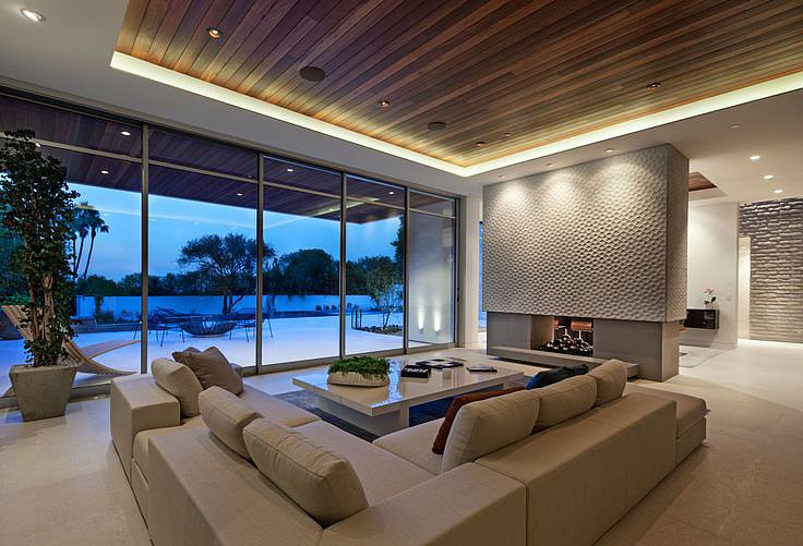 The living room offers views of the spacious yard. Source: The Agency