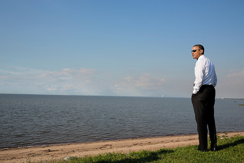 Obama enjoys a good view and a good pair of shades.