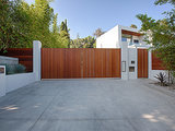 Linear wooden gates protect the property while providing curb appeal.  Source: The Agency