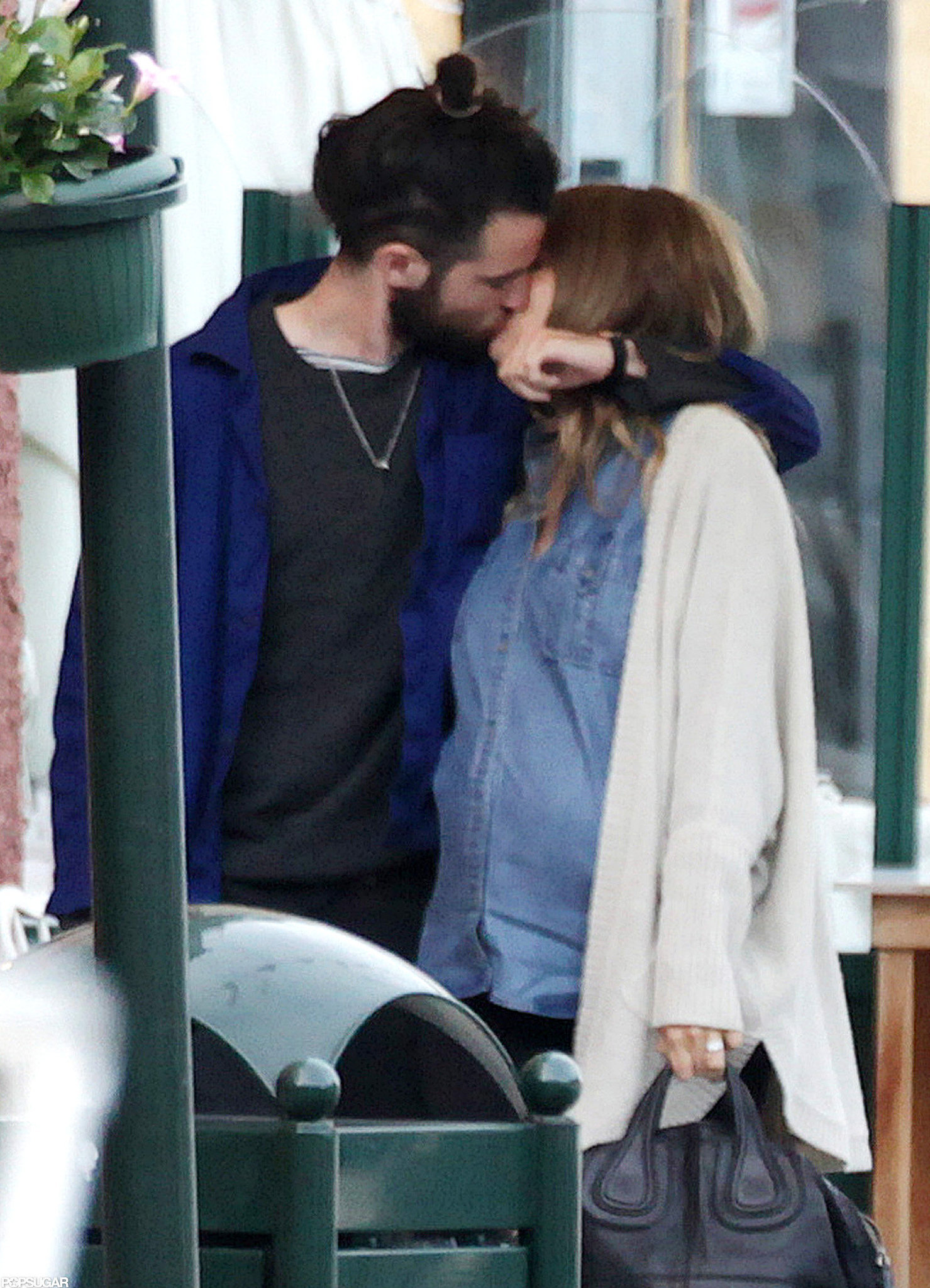 Tom Sturridge and Sienna Miller shared a passionate kiss on a May 2012 getaway to Portofino, Italy.