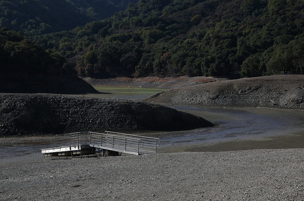 A boat dock sits on the dry ground at Steven Creek Reservoir in Cupertino, CA.