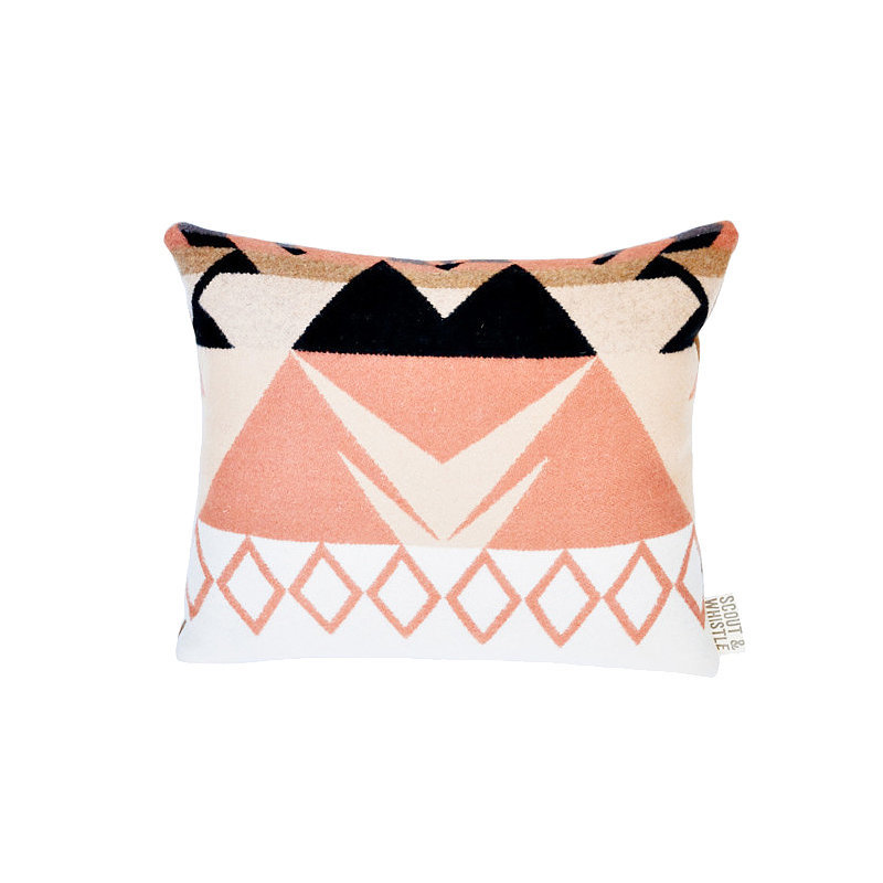 Punchy shades of pink and peach give this wool pillow ($68) a fresh, modern look. If you can't think of anyone to give it to, treat yourself!