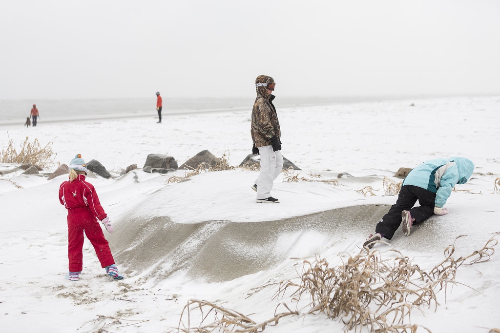 Snow made its way to Charleston, SC, where kids played on snow-covered sand dunes at the beach.
