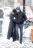 Lara Bingle and Sam Worthington tried to keep warm while taking a Wednesday stroll.