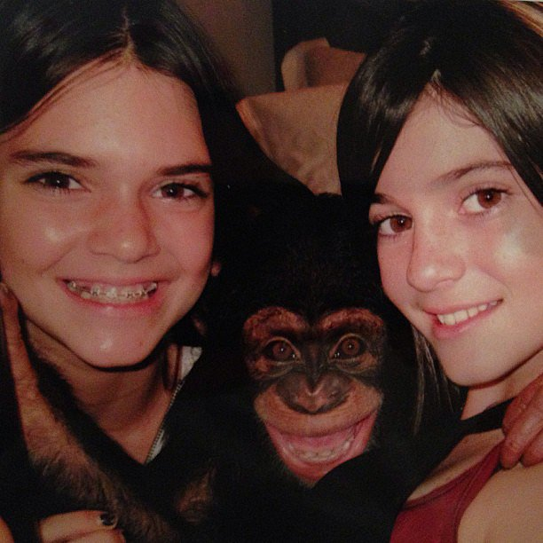 We're dying to know the context of this photo of Kim's younger siblings Kylie and Kendall with a monkey. Source: Instagram user kimkardashian