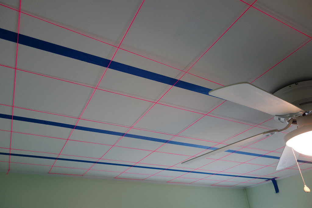 Using painter's tape and string, Brian created a ceiling grid to help him figure out where to drill holes.  Source: Imgur user MRDRC