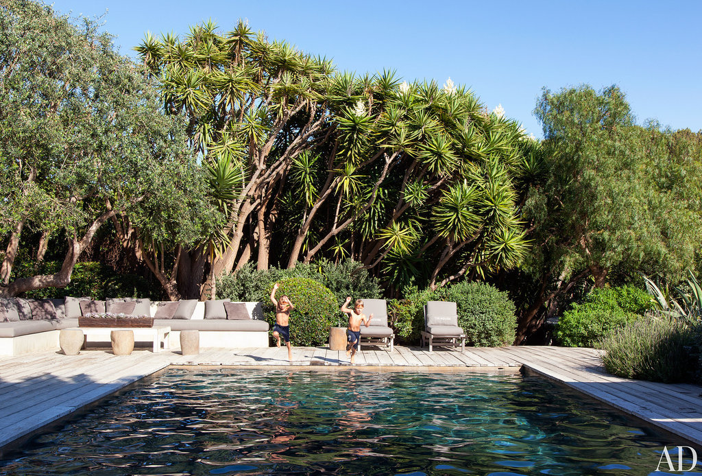 A recycled wood deck serves as the perfect place to soak in the California sun or to jump from into the pool. Cushioned seating covered in Perennials outdoor fabrics blend into the natural setting. Check out Architectural Digest for the full tour of Patrick Dempsey's house and even more celebrity homes! Source: Roger Davies via Architectural Digest