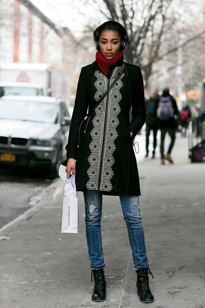 Zipped up in a statement coat.