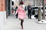 Her pink coat made dashing through the snow look totally cute.