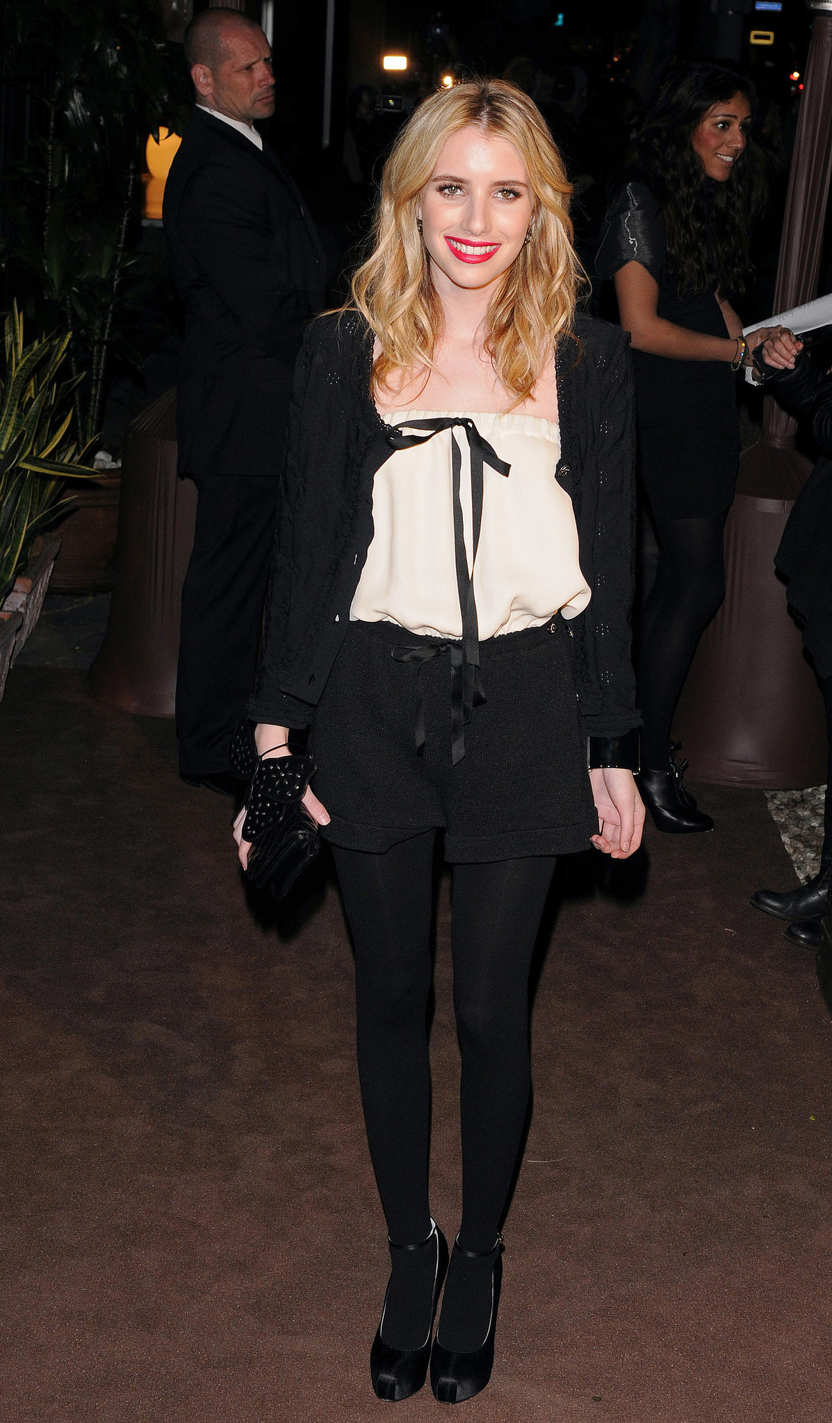 Emma punched up her menswear-inspired Chanel style with a red lip for an LA event in 2011.
