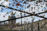 The Le Pont Des Arts bridge is covered in love locks.
