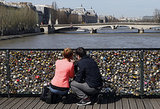 A couple locks down their love in Paris.