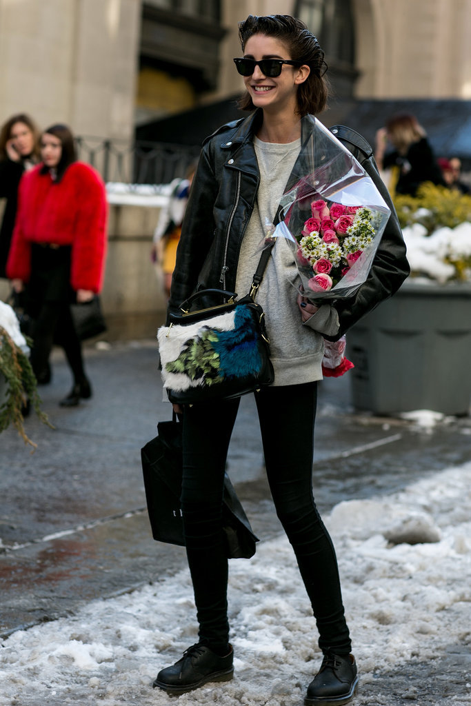 We can't decide which accessory we love more — the flowers or that furry Phillip Lim bag.