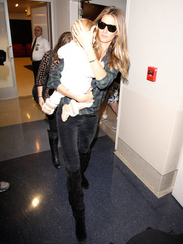 The corridors at LAX were the perfect runway to showcase Gisele Bündchen's signature laid-back style. She kept things simple by tucking a plaid shirt into dark skinnies and finished it off with knee-high boots.