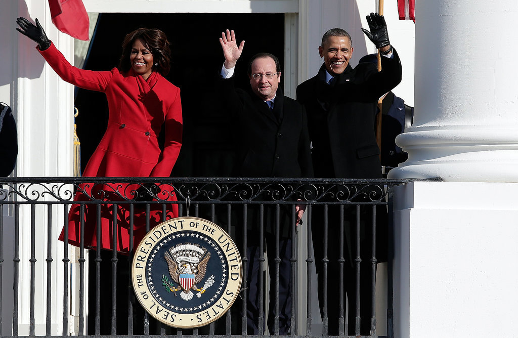 The presidents gave an official wave alongside Michelle.