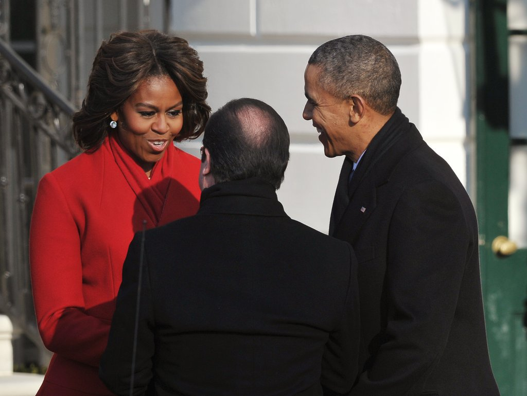 Michelle charmed them when they arrived, looking flawless in red.