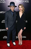 Johnny Depp joined fiancée Amber Heard for the premiere of her new movie, 3 Days to Kill, in LA on Wednesday.