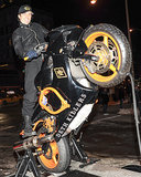 Orlando Bloom popped a fake wheelie outside the popup shop.