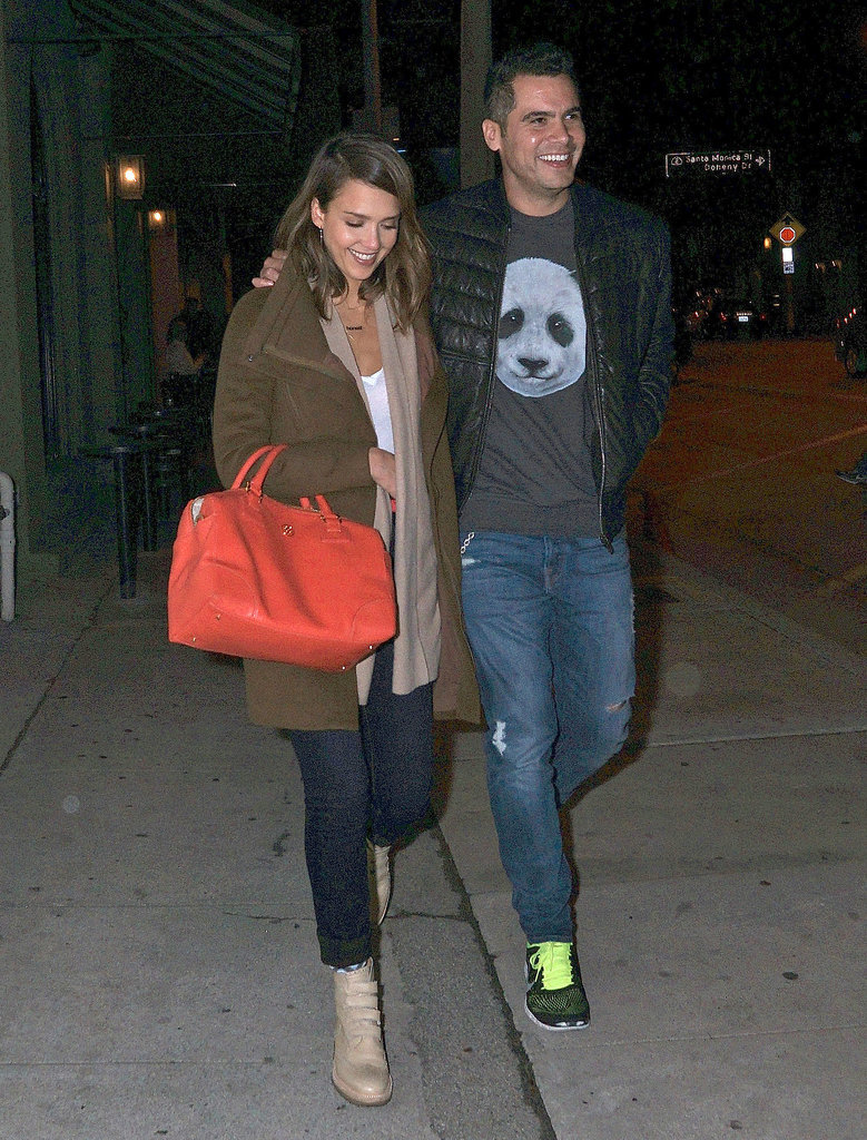 Cash Warren took his trendsetting lady — layered up in a cozy merino wool Inhabit cardigan, olive coat, and cuffed denim — out for a casual West Hollywood dinner. Alba completed her killer street style with neutral leather boots and a bold Tory Burch tote.