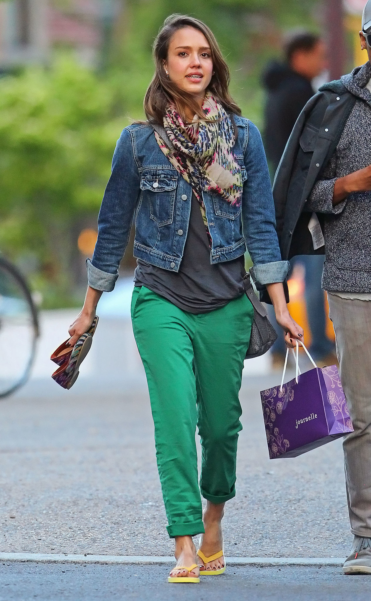 For a pedicure session in NYC, Alba swapped her colored denim for a classic jean jacket, preppy green pants, and a printed wrap scarf.