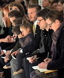 David Beckham sat with his daughter, Harper, and his sons at Victoria Beckham's fashion show.