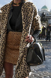 Temper leopard on leopard with a pared-down black bag.