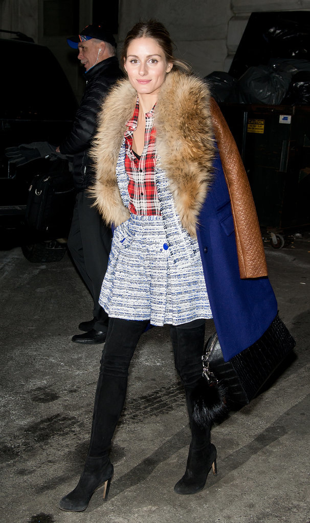 On her way into Marchesa, Olivia topped a tweed short suit and plaid button-down with her DVF coat.