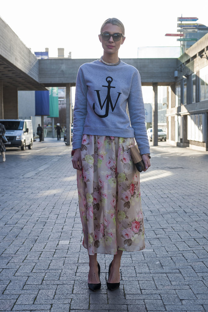 A J.W. Anderson jumper gets a girlie lift with a floral skirt.
