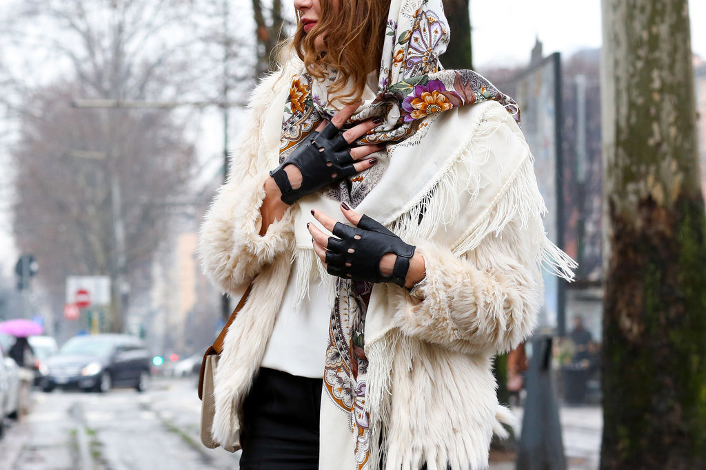 Badass biker gloves and a pretty scarf go surprisingly well together.